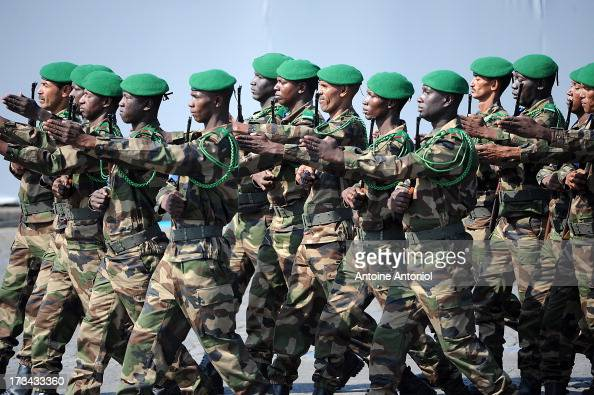 Malian soldiers parade during the Bastille Day parade on the Champs Elysees on July 14 2013 in Paris France The annual military ceremony is the...