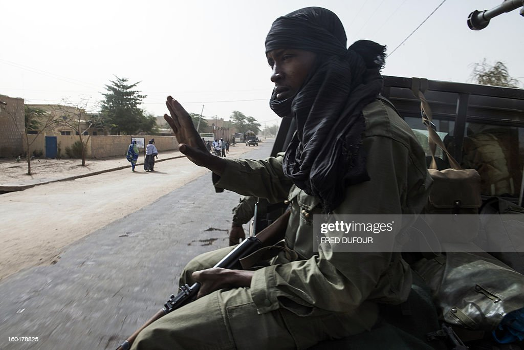 Malian soldiers patrol in the streets of Timbuktu on February 1, 2013, as French-led troops worked today to secure the last Islamist stronghold in the north after a lightning offensive against the extremists. The fabled desert city of Timbuktu, an ancient centre of Islamic learning, has been recaptured on January 28 by French-led forces in their offensive against Islamist rebels who have been occupying Mali's north since last April.