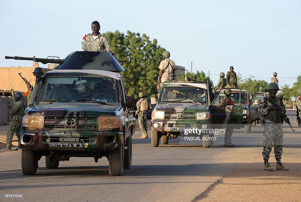 Malian soldiers patrol on February 10, 2013 in northern city of Gao. Fights between Islamist rebels and Malian soldiers broke out in the center of Gao, recently taken over by the French military to Malian armed Islamist groups, hit by two suicides bombings within two days. AFP PHOTO / PASCAL GUYOT