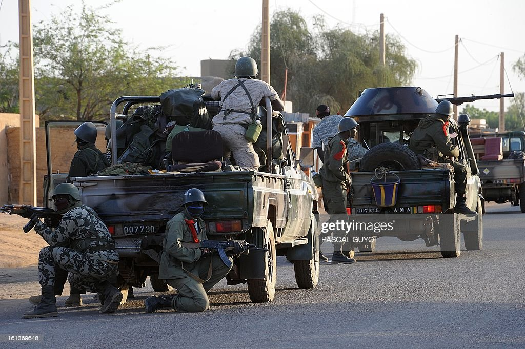 Malian soldiers patrol on February 10, 2013 in the Malian northern city of Gao. Fights between Islamist rebels and Malian soldiers broke out in the center of Gao, recently taken over by the French military to Malian armed Islamist groups, hit by two suicides bombings within two days.
