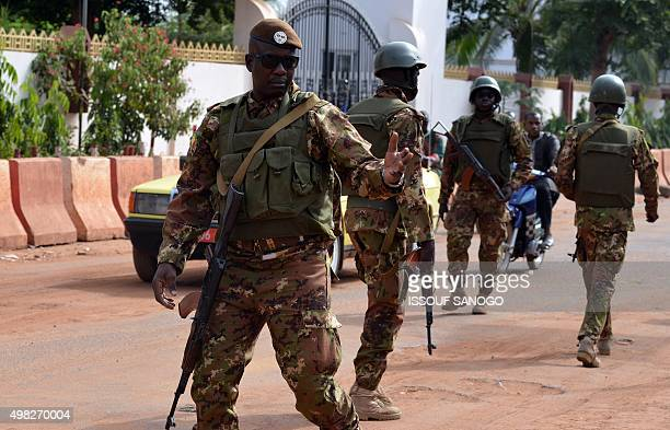 Malian soldiers patrol outside the Radisson Blu hotel in Bamako on November 22 2015 two days after a deadly attack claimed by AlQaeda affiliate group...