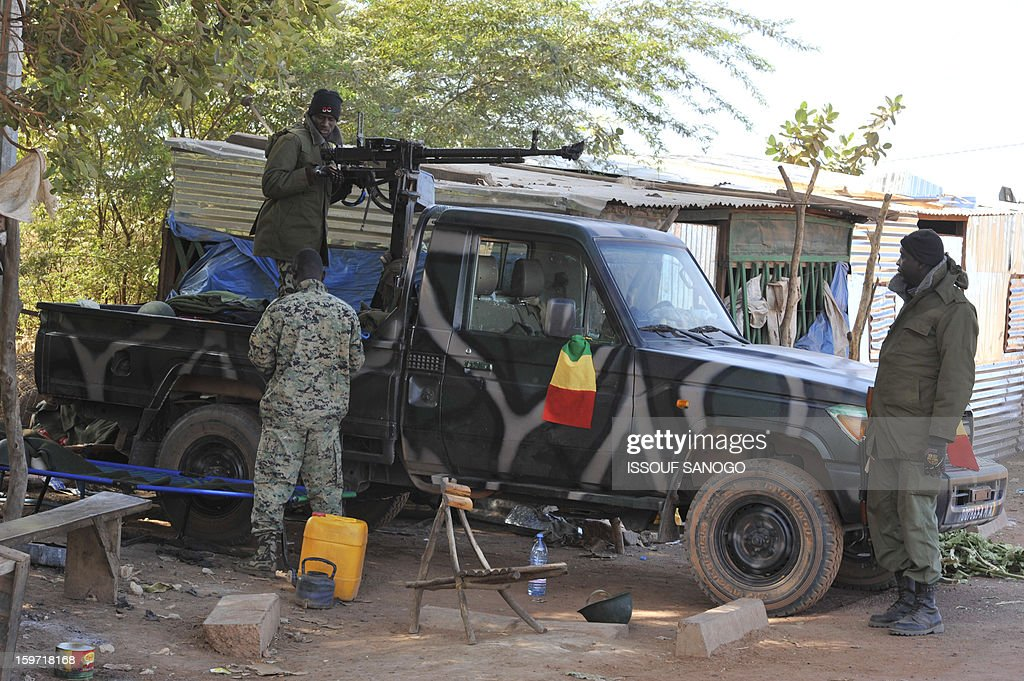 Malian soldiers prepare a military vehicule, on January 19, 2013, in city of Niono. Ivorian President Alassane Ouattara on January 19 called for a broader international commitment to the military operations in Mali, where Malian and French forces are battling Islamist militant groups that control the country's vast arid north. Some 2,000 members of MISMA (the International Mission for Mali Assistance), the African intervention force, are expected to be deployed by January 26. About 100 soldiers from Togo and Nigeria have already arrived in Bamako, and another 30 or so from Benin are en route to join them.