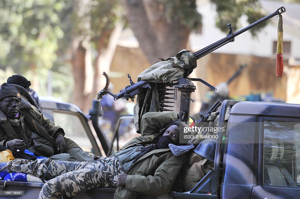 Malian soldiers rest at the back of a military vehicule, on January 19, 2013, in city of Niono. Ivorian President Alassane Ouattara on January 19 called for a broader international commitment to the military operations in Mali, where Malian and French forces are battling Islamist militant groups that control the country's vast arid north. Some 2,000 members of MISMA (the International Mission for Mali Assistance), the African intervention force, are expected to be deployed by January 26. About 100 soldiers from Togo and Nigeria have already arrived in Bamako, and another 30 or so from Benin are en route to join them.