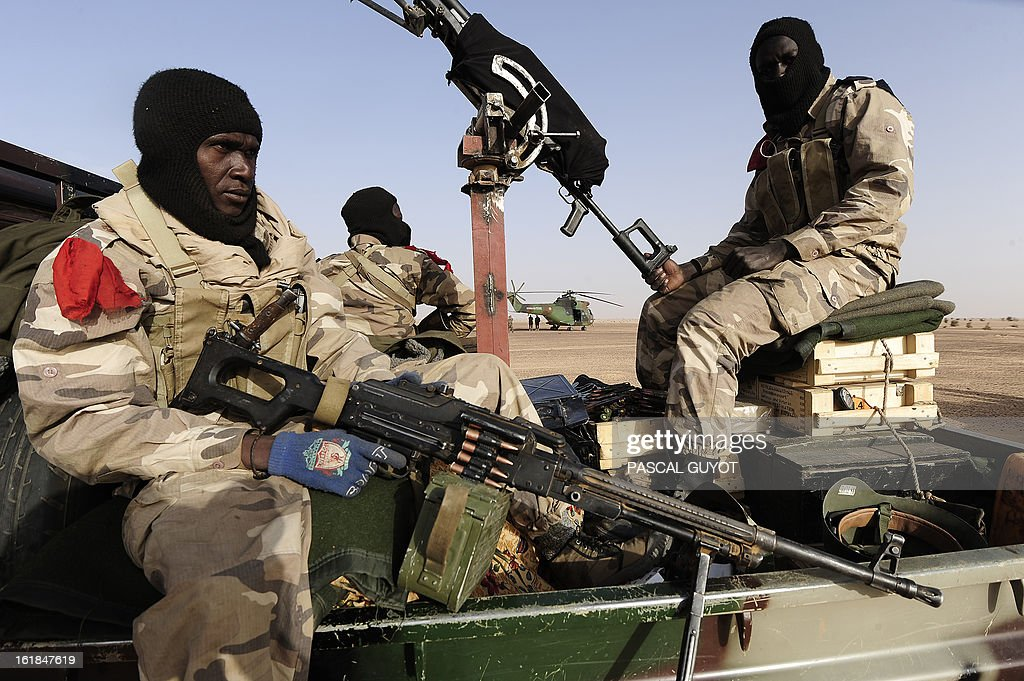 Malian soldiers sit aboard a vehicle as they enter Bourem northen Mali on February 17, 2013. Leaders in Africa's Sahel region called on Saturday for further efforts to support Mali as they announced new funds to back a West African force in the country. A French-led military intervention launched on January 11 has driven the Islamist rebels in Mali from the towns they controlled, but concerns remain over stability amid suicide attacks and guerrilla fighting. GUYOT
