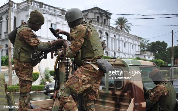 Malian soldiers stand guard in a military vehicle outside the presidential palace in Bamako on July 2 during a G5 Sahel summit to boost Western...