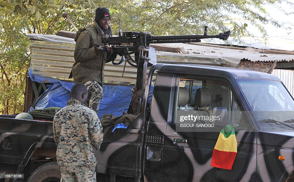 Malian soldiers stand next to a military vehicule, on January 19, 2013, in city of Niono. Ivorian President Alassane Ouattara on January 19 called for a broader international commitment to the military operations in Mali, where Malian and French forces are battling Islamist militant groups that control the country's vast arid north. Some 2,000 members of MISMA (the International Mission for Mali Assistance), the African intervention force, are expected to be deployed by January 26. About 100 soldiers from Togo and Nigeria have already arrived in Bamako, and another 30 or so from Benin are en route to join them.