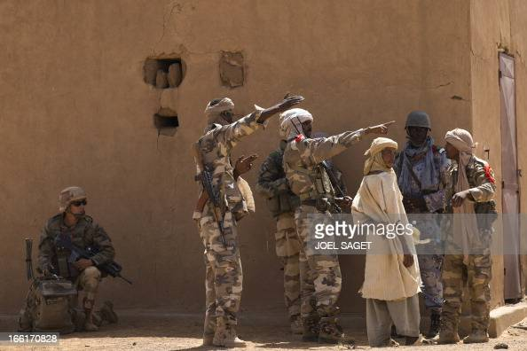 A Malian Special Force soldier and a French soldier question people during the Operation Gustav a hunt for Islamist fighters in a valley in northern...