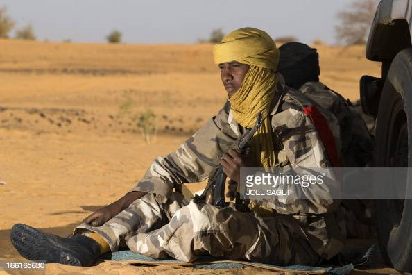 A malian Special Force soldier holds a gun as she sits on the ground during the Operation Gustav a hunt for Islamist fighters in a valley in northern...