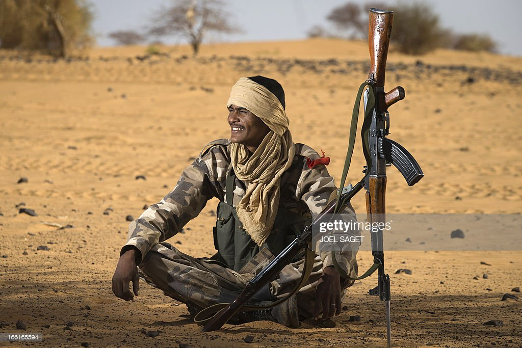 A malian Special Force soldier sits during the Operation Gustav, a hunt for Islamist fighters in a valley in northern Mali and one of France's largest military operations during its three-month intervention in its former colony, on April 9, 2013, 105 km North of Gao. Operation Gustav comes with France preparing to withdraw three-quarters of the 4,000 troops it deployed in January to block a feared advance on the Malian capital Bamako by Al Qaeda-linked insurgents. AFP PHOTO / JOEL SAGET