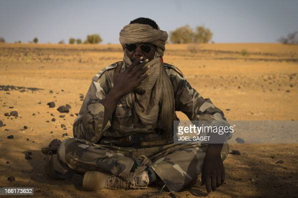 A Malian Special Force soldier smokes a cigarette 105 kms north of the northeastern Malian city of Gao on April 9 2013 during day two of Operation...