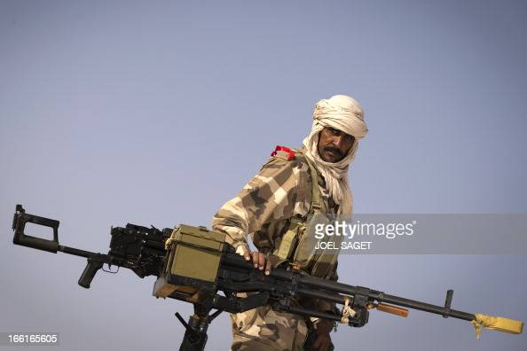 A malian Special Force soldier stands next to a machine gun during the Operation Gustav a hunt for Islamist fighters in a valley in northern Mali and...