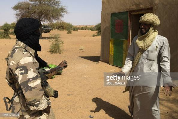 Malian Special Forces soldier speaks with a Malian during the Operation Gustav a hunt for Islamist fighters in a valley in northern Mali and one of...