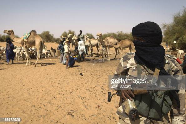 Malian Special Forces soldier stands guard near a well as they question Malian people on the Mujaho during the Operation Gustav a hunt for Islamist...