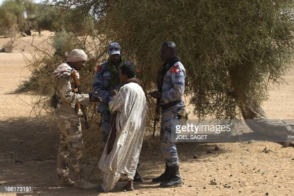 Malian Special Forces speak with a Malian during the Operation Gustav a hunt for Islamist fighters in a valley in northern Mali and one of France's...