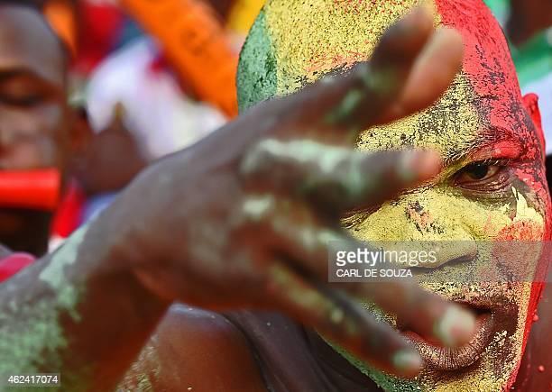 A Malian supporter cheers his team ahead of the 2015 African Cup of Nations group D football match between Guinea and Mali in Mongomo on January 28...
