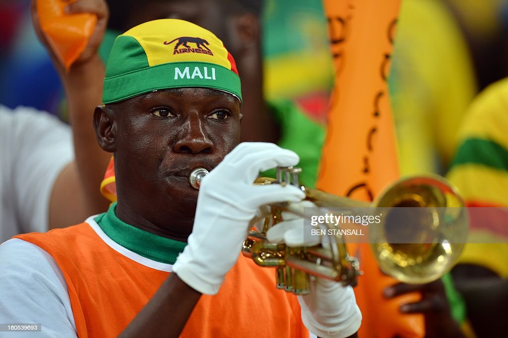 A Malian supporter plays trumpet ahead of the African Cup of Nation 2013 quarter final football match South-Africa vs Mali, on February 2, 2013 in Durban.