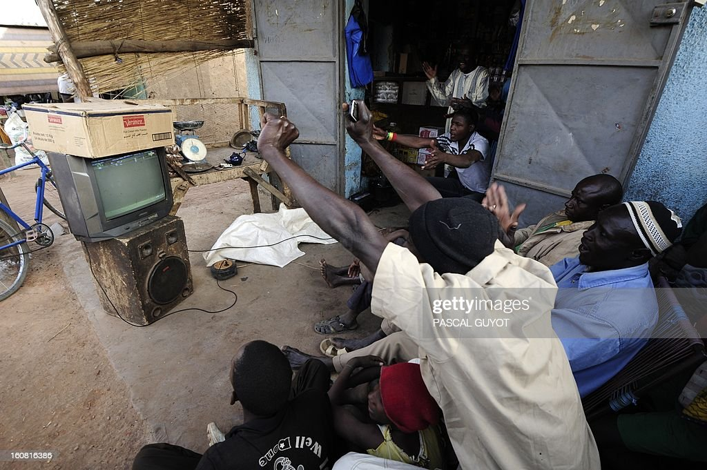 Malian supporters react on February 6, 2013 as they watch on a television in the center of the northern Malian city of Douentza a 2013 African Cup of Nations semi-final football match between Mali and Nigeria in Durban, South Africa.