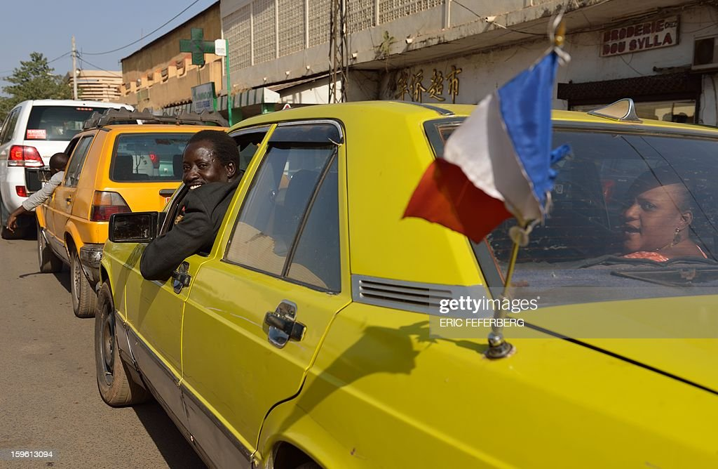 A Malian taxi driver displays a French flag on his car on January 17, 2013 in Bamako. EU foreign ministers agreed today to send military trainers for Mali's embattled army while funding an African-led intervention force and offering fresh help to France to fend off an Islamist rebel offensive.