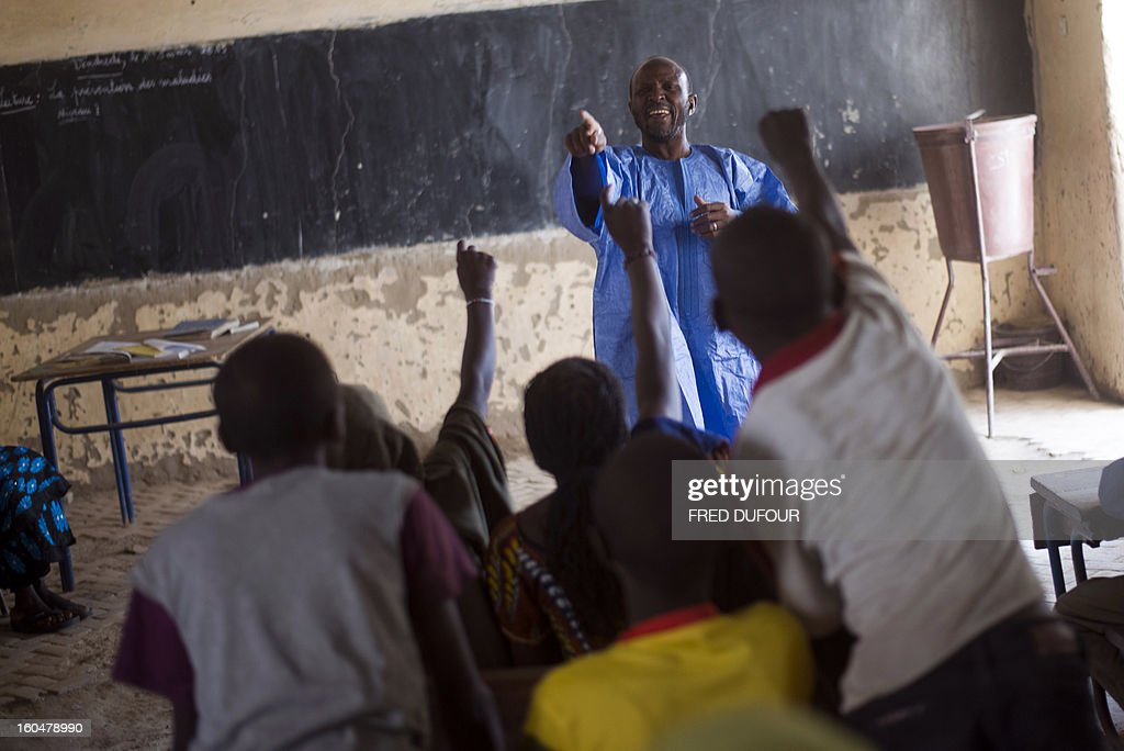 A Malian teacher gives a lesson in a classroom on February 1, 2013, in a school of Timbuktu which re-opens today after 10 months of islamists ruling in northern Mali. French-led troops worked today to secure the last Islamist stronghold in the north after a lightning offensive against the extremists. The fabled desert city of Timbuktu, an ancient centre of Islamic learning, has been recaptured on January 28 by French-led forces in their offensive against Islamist rebels who have been occupying Mali's north since last April.