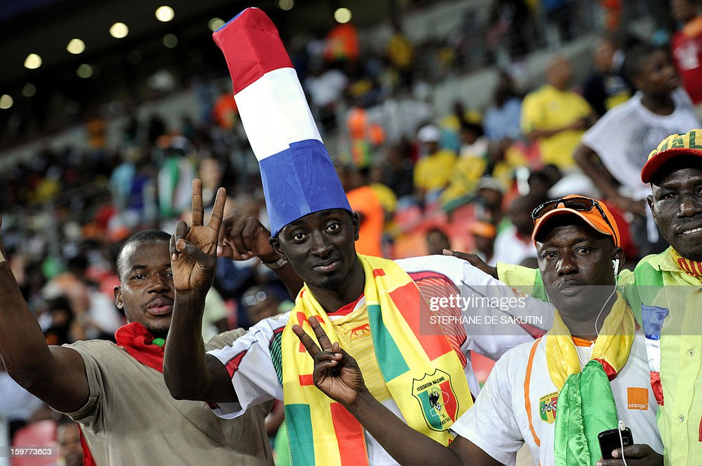 A Malian team supporter wears a hat shaped as a French flag during the 2013 African Cup of Nations football match between Mali and Niger at the Nelson Mandela Bay Stadium in Port Elizabeth on January 20, 2013.