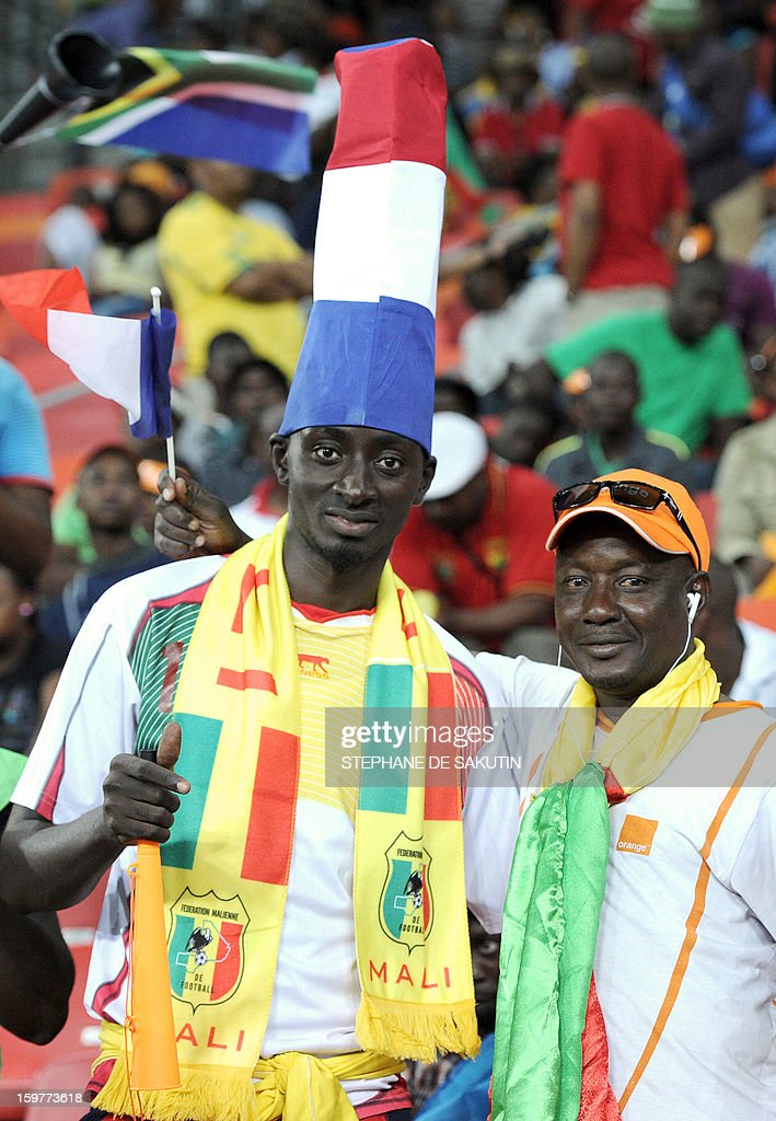 A Malian team supporter wears a hat shaped as a French flag during the 2013 African Cup of Nations football match between Mali and Niger at the Nelson Mandela Bay Stadium in Port Elizabeth on January 20, 2013. AFP PHOTO / STEPHANE DE SAKUTIN