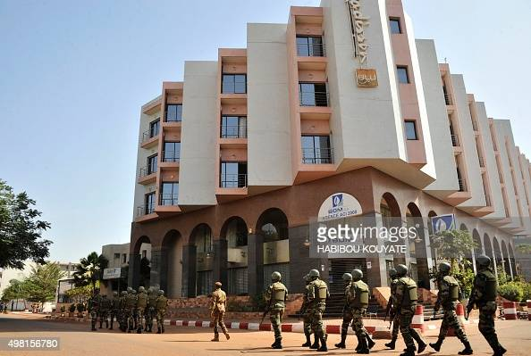 Malian troops patrol outside the Radisson Blu hotel in Bamako on November 21 2015 Investigators in Mali are hunting at least three people suspected...