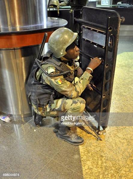 Malian troops take position inside the Radisson Blu hotel in Bamako on November 20 2015 Gunmen have taken 170 hostages and at least 20 people...