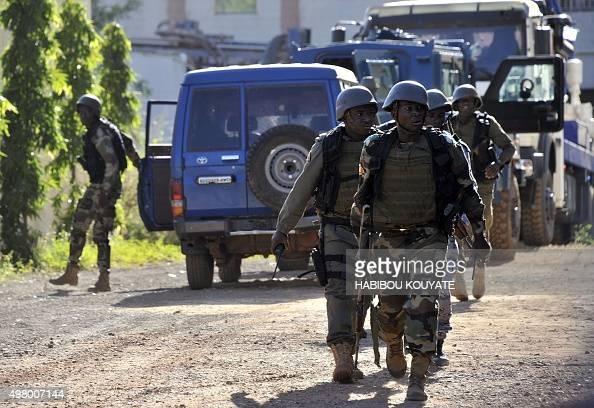 Malian troops take position near the Radisson Blu hotel in Bamako on November 20 2015 Gunmen went on a shooting rampage at the luxury hotel in Mali's...