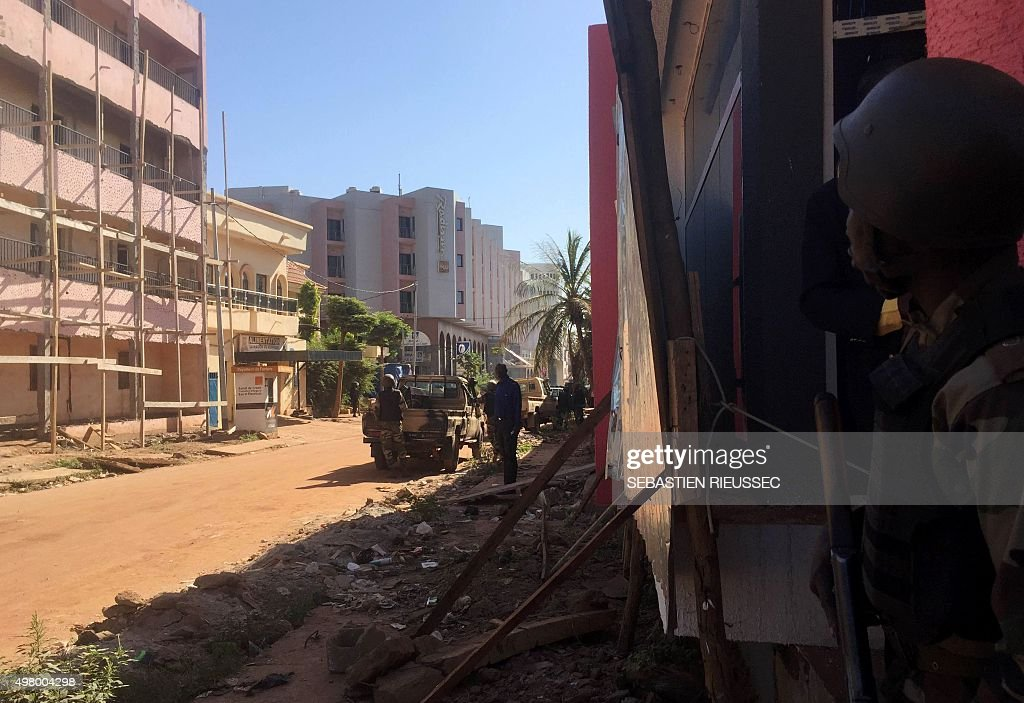 Malian troops take position outside the Radisson Blu hotel in Bamako on November 20 2015 Gunmen went on a shooting rampage at the luxury Radisson Blu...
