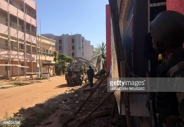 Malian troops take position outside the Radisson Blu hotel in Bamako on November 20 2015 Gunmen went on a shooting rampage at the luxury Radisson Blu...