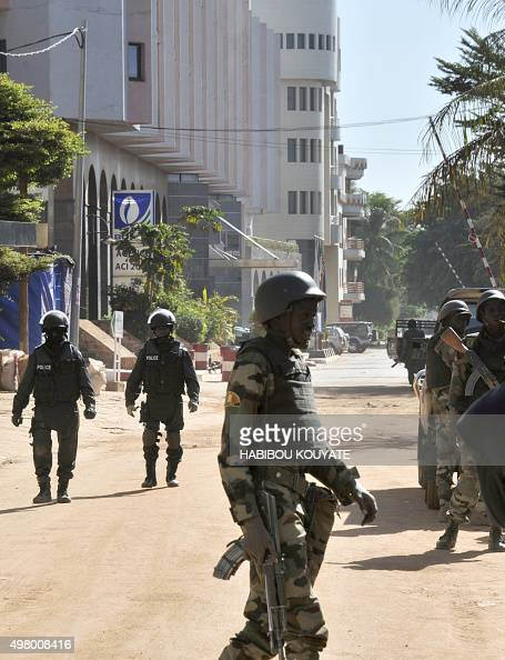 Malian troops take position outside the Radisson Blu hotel in Bamako on November 20 2015 Gunmen went on a shooting rampage at the luxury hotel in...