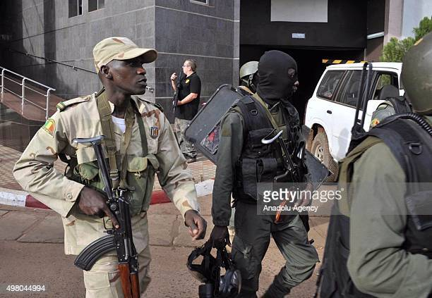 Malian troops take position outside the Radisson Blu hotel in Bamako on November 20 2015 Gunmen have taken 170 hostages and at least 20 people...