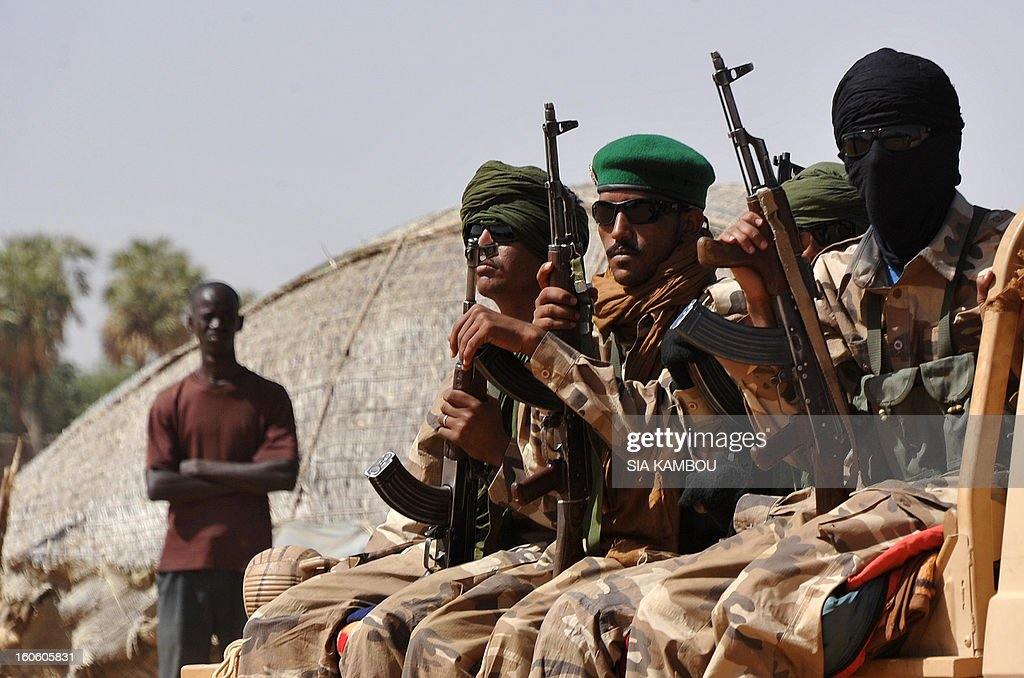 Malian tuareg soldiers patrol in the streets of Gao on February 3, 2013. Malian tuareg troops are back in Gao after taking shelter with colonel Gamou in Niger during the islamist occupation of this northern Mali key city.