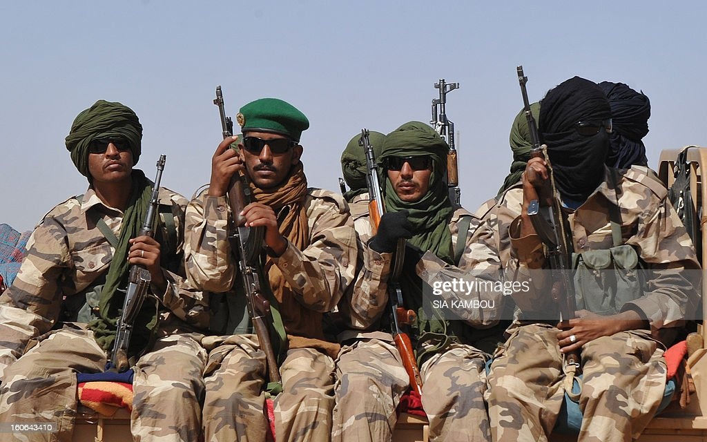 Malian tuareg soldiers patrol in the streets of Gao on February 3, 2013. Malian tuareg troop are back in Gao after taking shelter with colonel Gamou in Niger during the islamist occupation of this northern Mali key city.
