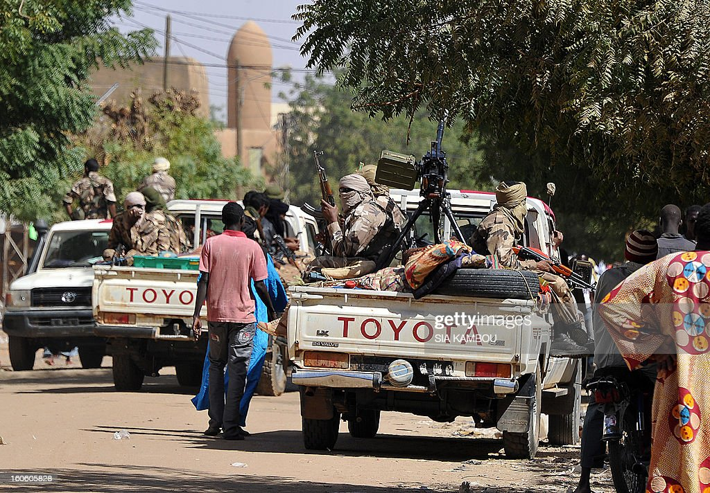 Malian tuareg soldiers patrol in the streets on February 3, 2013 in Gao. Malian tuareg troop are back in Gao after taking shelter with colonel Gamou in Niger during the islamist occupation of this northern Mali key city.