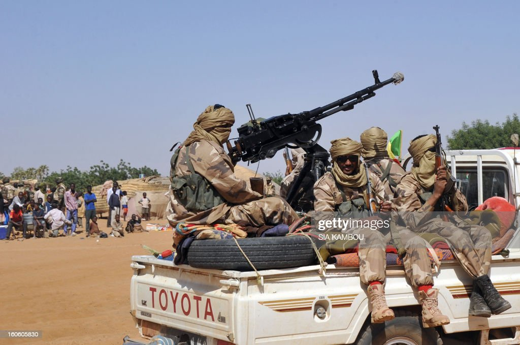 Malian tuareg soldiers patrol in the streets on February 3, 2013 in Gao. Malian tuareg troops are back in Gao after taking shelter with colonel Gamou in Niger during the islamist occupation of this northern Mali key city. AFP PHOTO / SIA KAMBOU
