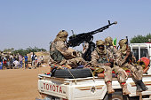 Malian tuareg soldiers patrol in the streets on February 3 2013 in Gao Malian tuareg troops are back in Gao after taking shelter with colonel Gamou...