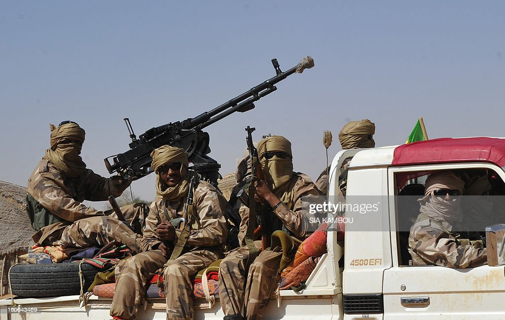 Malian tuareg soldiers patrol in the streets on February 3, 2013 in Gao. Malian tuareg troop are back in Gao after taking shelter with colonel Gamou in Niger during the islamist occupation of this northern Mali key city. AFP PHOTO / SIA KAMBOU