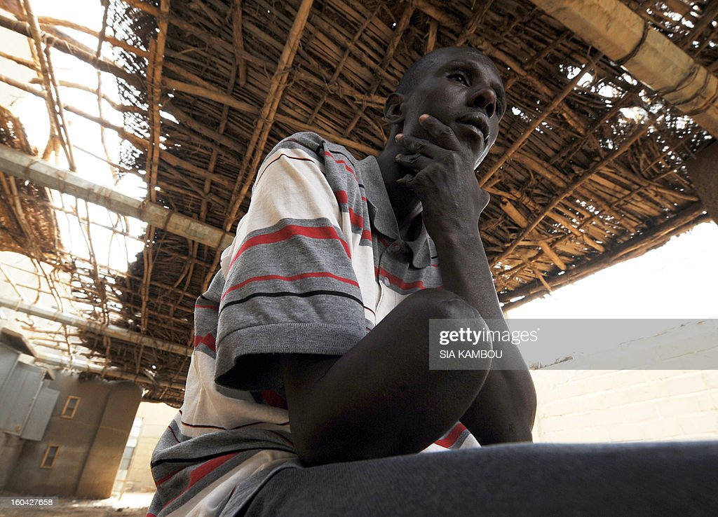 A Malian, who was amputated for alleged theft by Islamists of the Movement for Oneness and Jihad in West Africa (MUJAO), shows his missing limb on January 31, 2013 in the northern Malian city of Gao. The city was controlled by Islamists who applied Islamic sharia law with public punishments, including stoning and amputation of limbs. Gao was retaken on January 26 by French and Malian troops in a major boost to the French-led offensive against the Al Qaeda-linked rebels, who have been holding Mali's vast desert north since last April. FP PHOTO / SIA KAMBOU