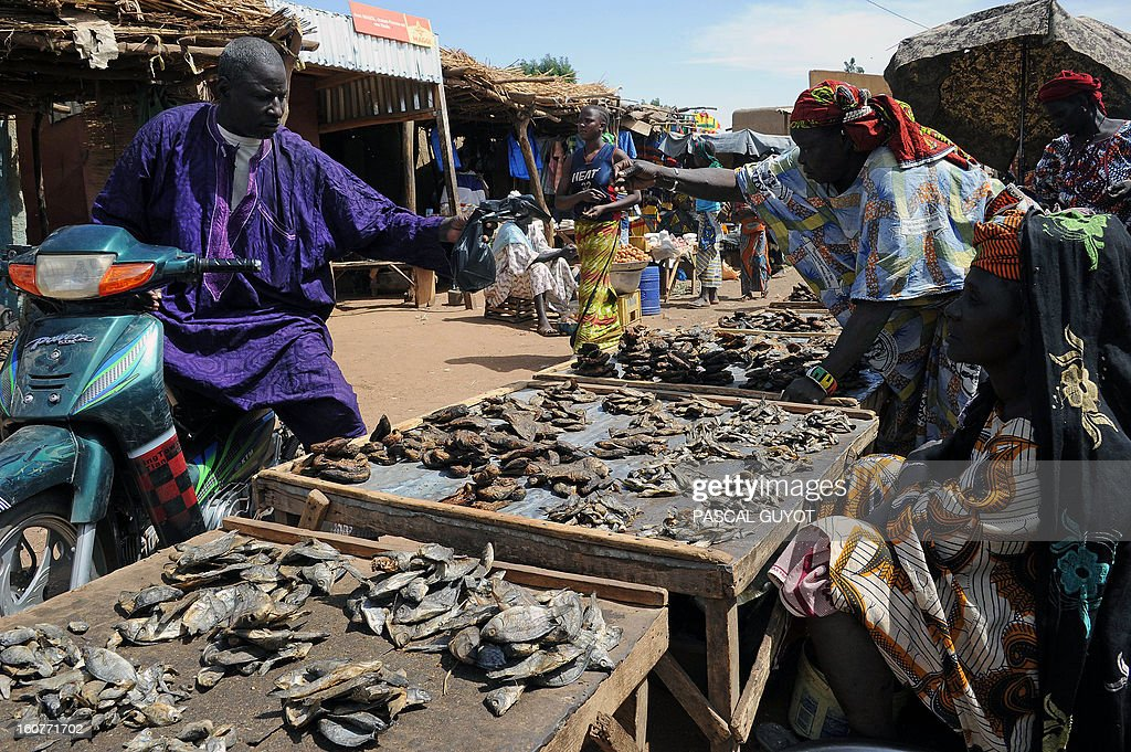 Malian women sell dried fish on February5, 2013 in Douentza market. The town was retaken by French and Malian troops in January.