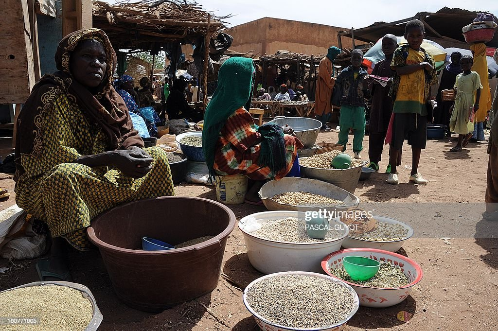 Malian women sell meal on February 5, 2013 in the Douentza market .The town was retaken by French and Malian troops in January.