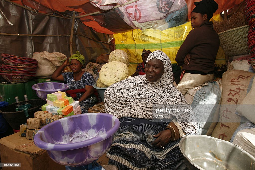 Malian women sell products at a stall in a makeshift market in Ndiassane, Senegal, which caters to Muslims coming to the city for an annual pilgrimage organized by the 'Khadrya brotherhood', on January 30, 2013. This year's pilgrimage in Ndiassane is dedicated to 'Peace in Mali' and is an occasion for many Malian merchants to sell goods to pilgrims. AFP PHOTO / Mamadou Toure BEHAN