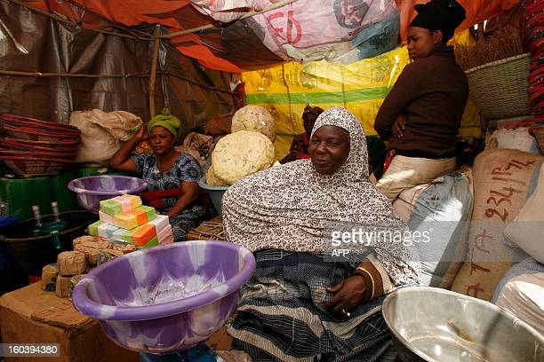 Malian women sell products at a stall in a makeshift market in Ndiassane Senegal which caters to Muslims coming to the city for an annual pilgrimage...