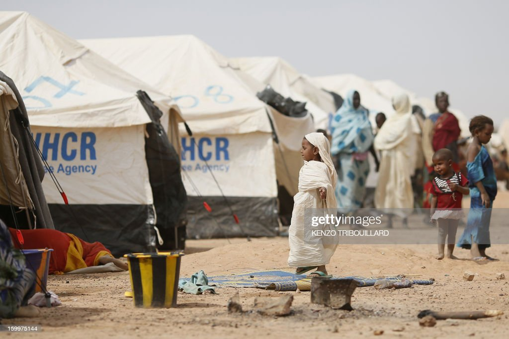 A Malian young girl plays in a refugee camp on January 24, 2013, near the Malian border in Burkina Faso. The conflict in Mali has caused nearly 150,000 people to flee the country, while about another 230,000 are internally displaced, the UN humanitarian agency said on January 15, 2013. According to OCHA, the UN High Commissioner for Refugees has registered 144,500 refugees in neighbouring countries -- 54,100 in Mauritania, 50,000 in Niger, 38,800 in Burkina Faso and 1,500 in Algeria.