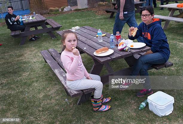 Malibu Chartrand and Diamitte Cura eat dinner at an evacuation center on May 7 2016 in Lac La Biche Alberta Wildfires which are still burning out of...
