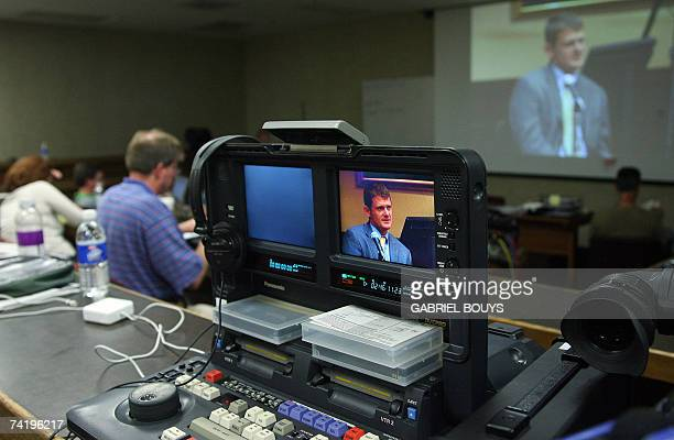 Members of the media watch a video as US cyclist Floyd Landis testifies 19 May 2007 at the arbitration hearing of the 2006 Tour de France champion at...