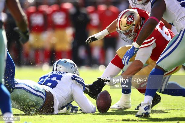 Maliek Collins of the Dallas Cowboys and Brandon Fusco of the San Francisco 49ers dive for a loose ball during their NFL game at Levi's Stadium on...