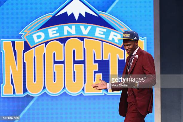 Malik Beasley celebrates on stage after being drafted 19th overall by the Denver Nuggets in the first round of the 2016 NBA Draft at the Barclays...