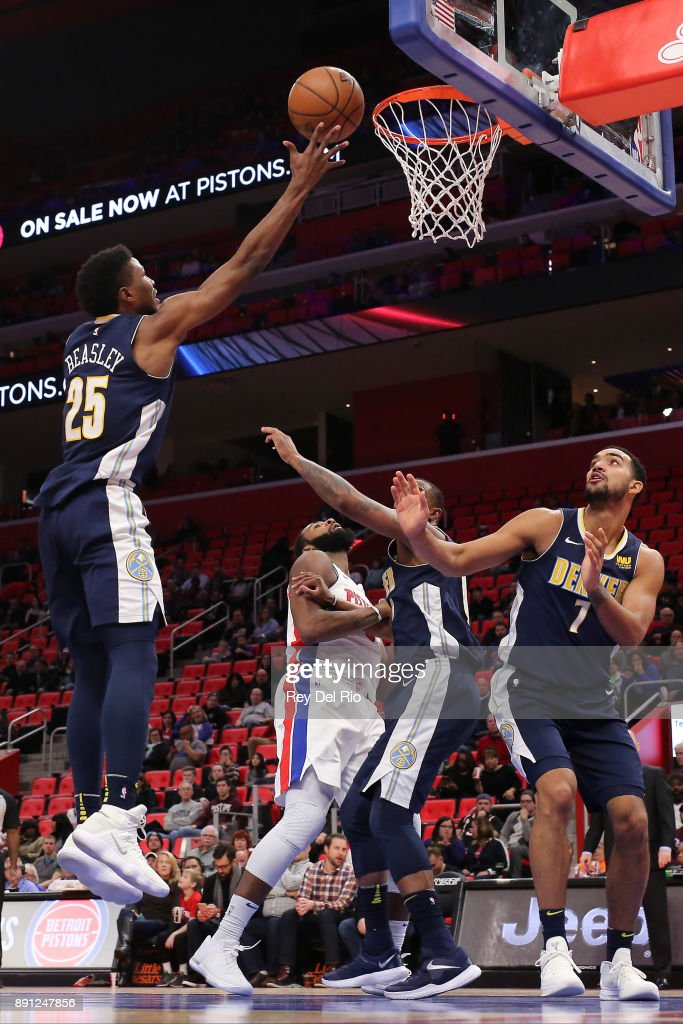 Malik Beasley #25 of the Denver Nuggets grabs a rebound during the game against the Detroit Pistons at Little Caesars Arena on December 12, 2017 in Detroit, Michigan.