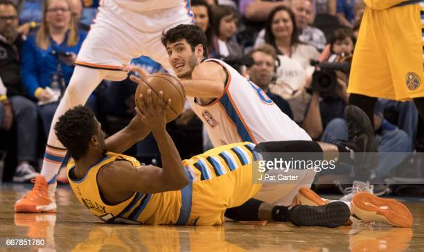 Malik Beasley of the Denver Nuggets tries to get ball away from Alex Abrines of the Oklahoma City Thunder during the second half of a NBA game at the...